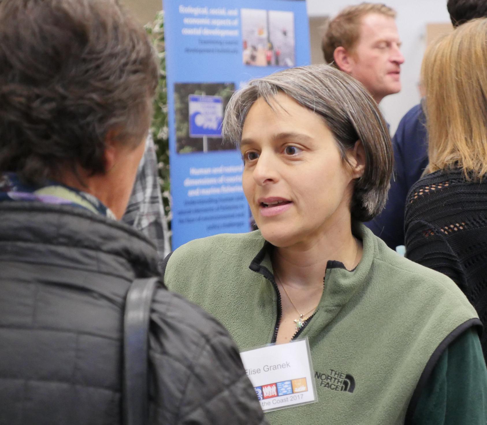 Elise Granek talks to a person