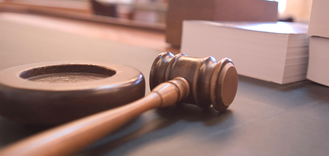Gavel and law book symbolize the U.S. justice system