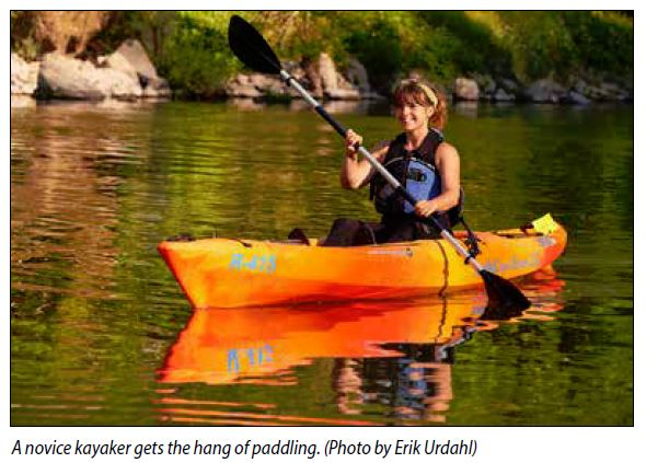 Novice kayaker gets the hang of paddling
