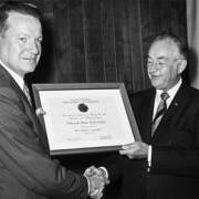 OSU President Robert MacVicar accepts Sea Grant certification from U.S. Commerce Secretary Maurice Stans, 1971