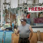 A crab fisherman in Newport answers questions during a Shop at the Dock tour.
