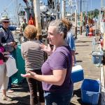 Ruby Moon, formerly with Oregon Sea Grant, briefs dock walk participants on what to expect on Newport's commercial fishing docks. (Photo by Pat Kight)