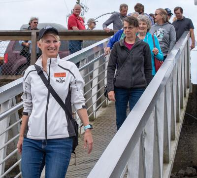 Amanda Gladics, a marine fisheries specialist with Oregon Sea Grant, leads a Shop at the Dock tour in Garibaldi.