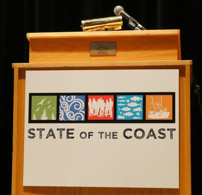 Podium with sign for State of the Coast