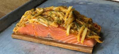 Salmon filet on a cedar plank ready to cook