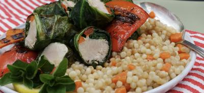Albacore tuna loins wrapped in swiss chard leaves, with roasted red pepper over couscous