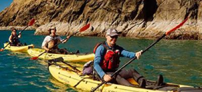 three kayaks at sea