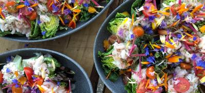 Shrimp and crab gem louie salads with edible flowers on a platter