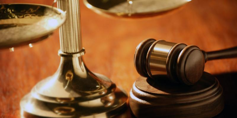 """A gavel and the """"scales of justice"""" symbolize the U.S. legal system."""