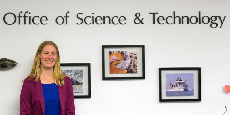 Photo of 2016 Oregon Sea Grant Knauss Fellow Laura Ferguson, at work in her office at NOAA in Silver Springs, Maryland.