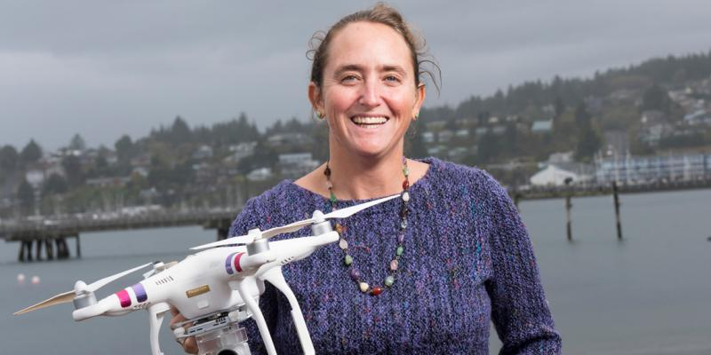 Leigh Torres holds a drone