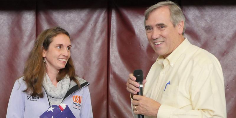 U.S. Senator Jeff Merkley recognizes Sea Grant Shop at the Dock program at a town hall meeting in Newport.