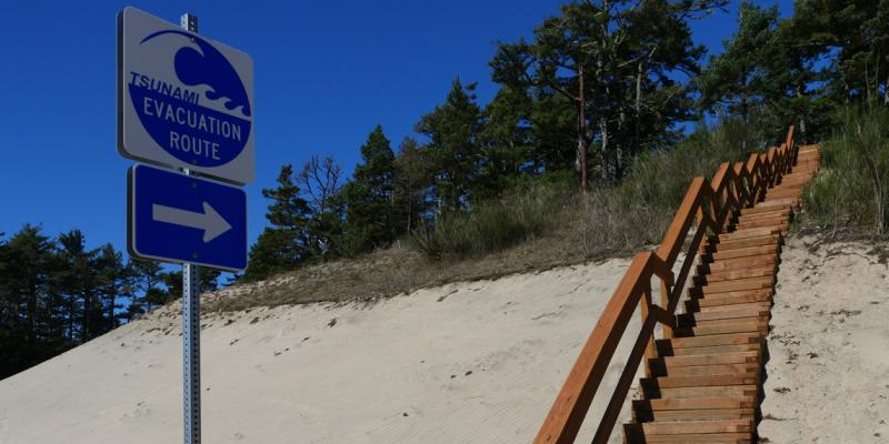 tsunami evacuation sign by hill