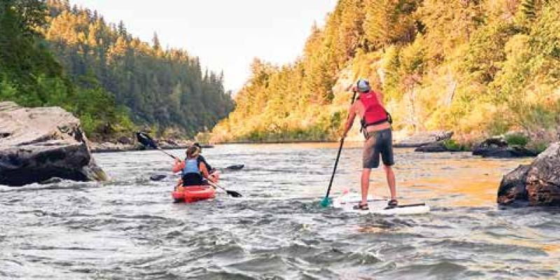 people on river in a kayak and on a paddle board