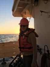 Anna Bolm aboard a research vessel at sunset (Photo Courtesy of Anna Bolm)