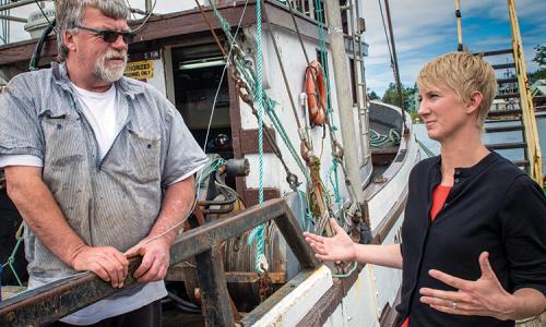 Amanda Gladics, Oregon Sea Grant Extension Fisheries Specialist, talks with local fisherman.