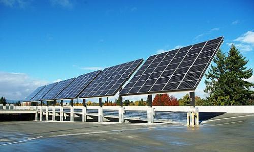 A large array of solar panels at the Hillsboro Intermodal Transit Facility