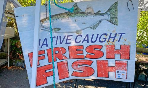 sign says native caught fresh fish