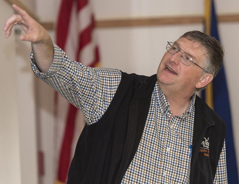 Tim Miller-Morgan gestures while giving a presentation.