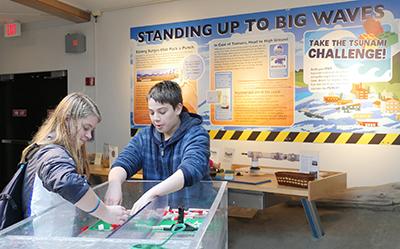 children at the tsunami wave tank exhibit at Hatfield Visitor Center