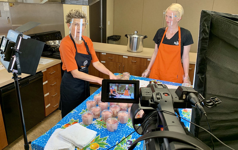 Registered dietitian, Kelly Streit, and Oregon Sea Grant Extension fisheries specialist, Amanda Gladics film a tuna canning video.